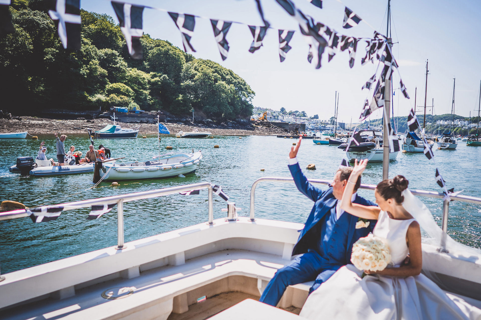 Married-couple-arriving-to-reception-fowey-hall-hotel-cornwall-on-boat