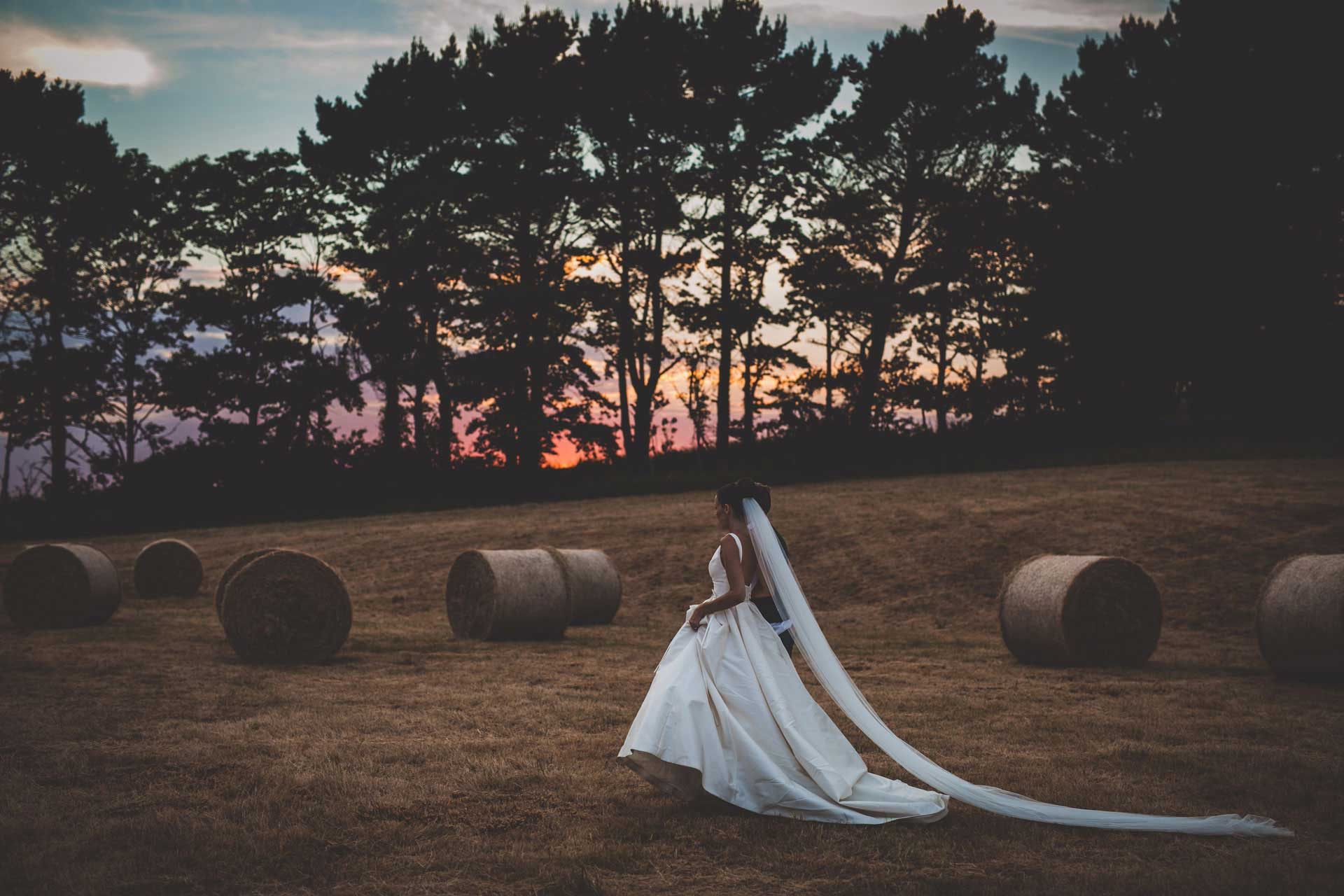 Wedding-sunset-photographers-hay-bail-feild-classic-wedding-dress